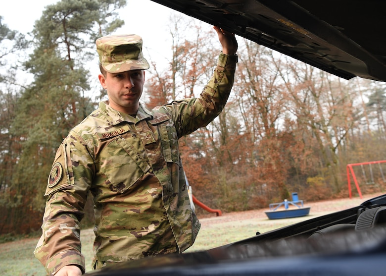 U.S. Air Force Senior Airman Eric Mrkonja, Deployment Transition Center lodging manager and vehicle control officer, inspects a vehicle at Ramstein Air Base, Germany, Nov. 25, 2019. As a member of the DTC, Mrkonja helps provide critical reintegration skills and decompression opportunities for service members returning home after deployment. (U.S. Air Force photo by Staff Sgt. Kirby Turbak)