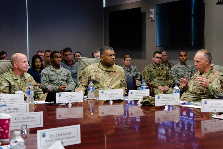 """Col. Chad J. Hartman (right), commander of the Air Force Technical Applications Center, briefs Air Force Vice Chief of Staff Gen. Stephen W. """"Seve"""" Wilson (left) and Air Force Deputy Chief of Staff for Strategic Deterrence and Nuclear Integration Lt. Gen. Richard Clark (center) on algorithmic warfare operations being conducted at the Department of Defense's sole nuclear treaty monitoring center.  Wilson and Clark visited AFTAC, headquartered at Patrick AFB, Fla., Dec. 4, 2019 for a current mission update.  (U.S. Air Force photo by Susan A. Romano)"""