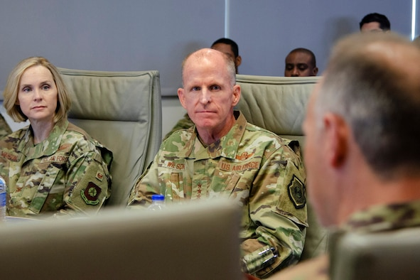 """Gen. Stephen W. """"Seve"""" Wilson, Air Force Vice Chief of Staff, listens as Col. Chad J. Hartman (foreground), commander of the Air Force Technical Applications Center, briefs the general Dec. 4, 2019 on how the U.S. technical surveillance center of excellence is addressing """"wicked problems"""" that nuclear nonproliferation poses to senior defense officials.  Also pictured is Col. Brande H. Walton, Vice Commander for the 45th Space Wing, Patrick AFB, Fla.  (U.S. Air Force photo by Susan A. Romano)"""