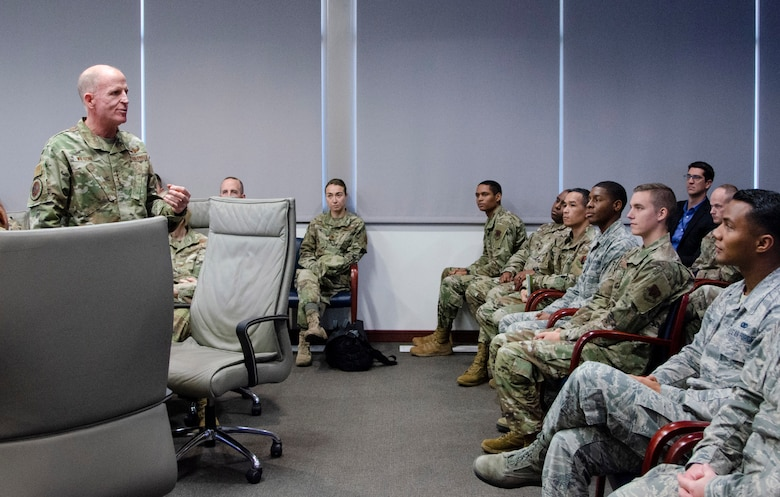 """Gen. Stephen W. """"Seve"""" Wilson (standing), Air Force Vice Chief of Staff, meets with Airmen from the Air Force Technical Applications Center, Patrick AFB, Fla., Dec. 4, 2019 to commend members of the Department of Defense's sole nuclear treaty monitoring center for their work to deter global adversaries.  """"AFTAC has some really smart people here who have come up with solutions to some very hard problems,"""" Wilson said.  (U.S. Air Force photo by Susan A. Romano)"""
