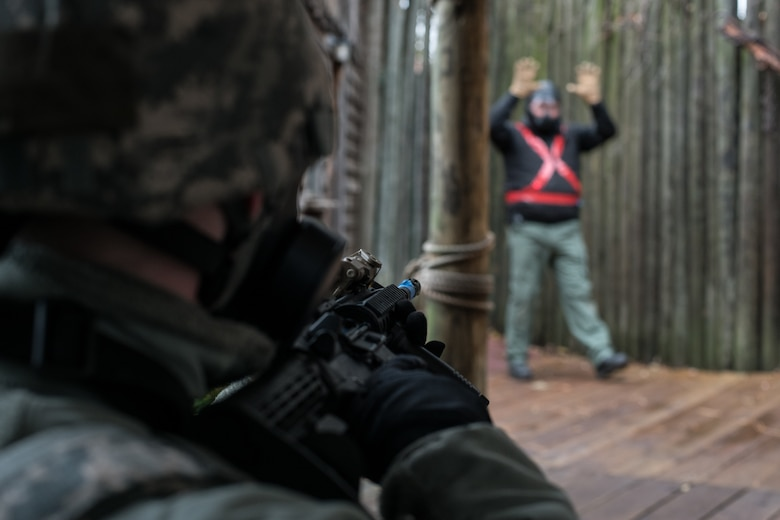 Airman 1st Class Harley Jones, a security forces Airman with the 137th Special Operations Security Forces Squadron from Oklahoma City, holds his weapon on a simulated hostage-taker as he issues verbal commands for surrender during SWAT training conducted by the Oklahoma County Sheriff's Office in Oklahoma City on Nov. 5, 2019. (U.S. Air National Guard photo by Staff Sgt. Brigette Waltermire)