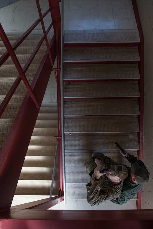 Staff Sgt. James Lunsford (left), with the 137th SOSFS, and Jared Johnson (right), with Ardmore SWAT, tactically clear a stairwell during SWAT training conducted by the Oklahoma County Sheriff's Office at Southern Nazarene University in Bethany, Okla., on Nov. 5, 2019. Johnson, a former Marine Corps infantryman, became a K-9 officer with Ardmore Police Department in 2015 and has worked with the department ever since. Lunsford and Johnson spoke over the course of the training about Johnson's experiences in that field because Lunsford was in the process of applying to the Oklahoma City Police Department to also become a K-9 handler. (U.S. Air National Guard photo by Staff Sgt. Brigette Waltermire)