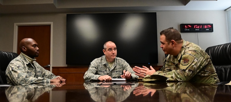U.S. Air Force Master Sgt. Jeremy Cornelius, center, 118th Wing public affairs superintendent, Tennessee Air National Guard, facilitates a small group discussion with Maj. Robert Dunbar, right, and Airman 1st Class Willie Williams, left, for the 118th WG's resiliency tactical pause Dec. 4, 2019 at Berry Field Air National Guard Base, Nashville, Tennessee. The discussion was part of the Air Force-wide initiative ordered by Air Force Chief of Staff Gen. David Goldfein to combat the rising numbers of suicides in the Air Force.