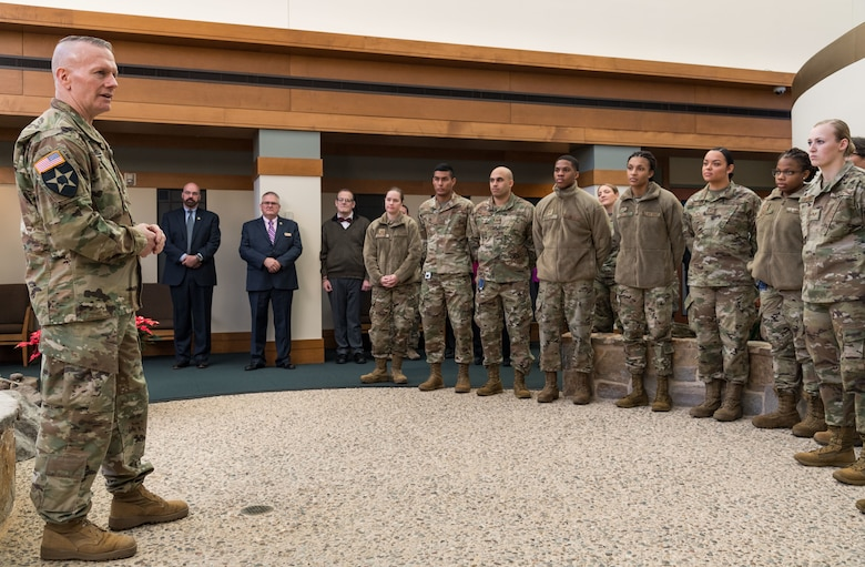 Army Command Sgt. Maj. John Wayne Troxell, senior enlisted advisor to the chairman of the Joint Chiefs of Staff, speaks to Air Force Mortuary Affairs Operations personnel, Dec. 3, 2019, on Dover Air Force Base, Del. Troxell thanked them for their service in providing dignity, honor and respect to fallen service members. (U.S. Air Force photo by Roland Balik)