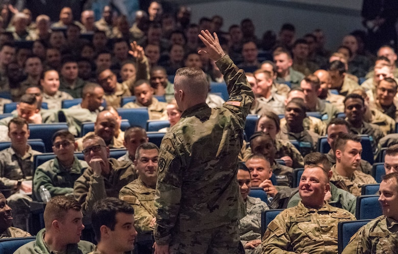 Army Command Sgt. Maj. John Wayne Troxell, senior enlisted advisor to the chairman of the Joint Chiefs of Staff, speaks to Team Dover members during an all call Dec. 3, 2019, inside the base theater at Dover Air Force Base, Del. Troxell addressed air mobility's role in national defense and the importance of readiness during the event. (U.S. Air Force photo by Roland Balik)