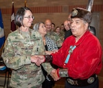 Erwin De Luna and Brooke Army Medical Center Commanding General Brig. Gen. Wendy Harter lead BAMC staff members in a traditional Native American dance during the National American Indian Heritage Month observance Nov. 26. De Luna is president of the board of directors for the United San Antonio Pow Wow Inc., and is of Taos Pueblo and Navajo ancestry.