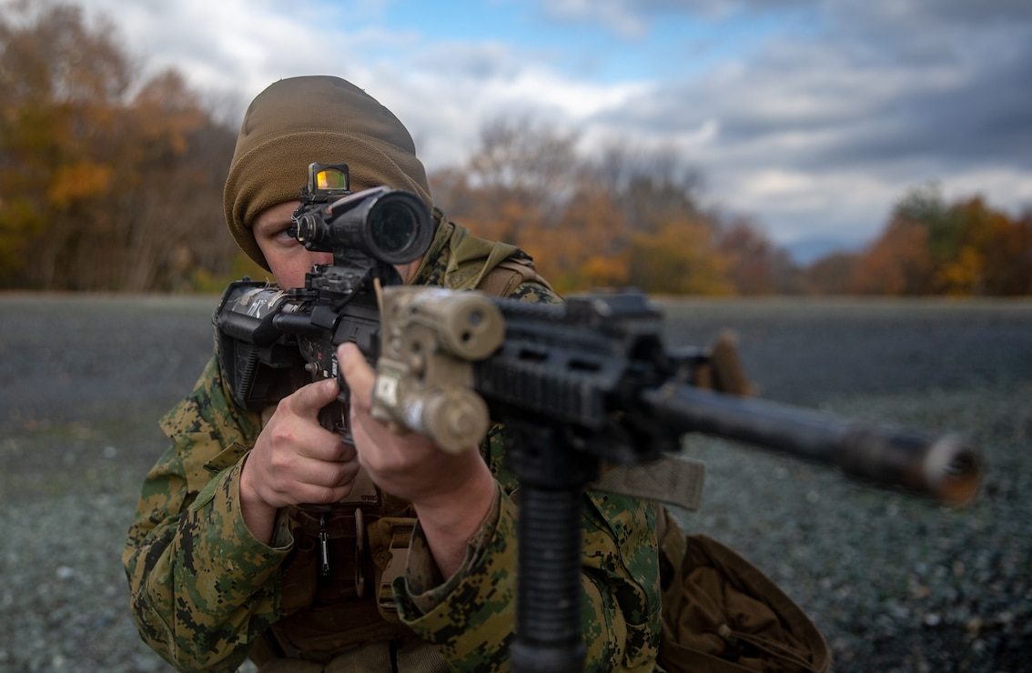 A U.S. Marine holds security during a patrol at Forest Light Middle Army in Aibano Training Area, Shiga, Japan, Dec. 3.