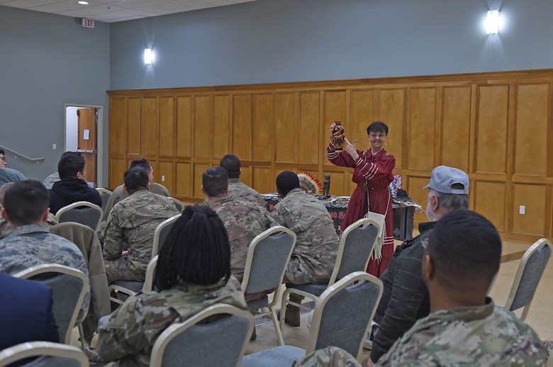 A briefer speaks to an audience