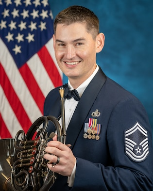 Official photo of SMSgt Brett Miller, French hornist with the concert band, one of six ensembles in The United States Air Force Band, Joint Base Anacostia-Bolling, Washington, D.C.
