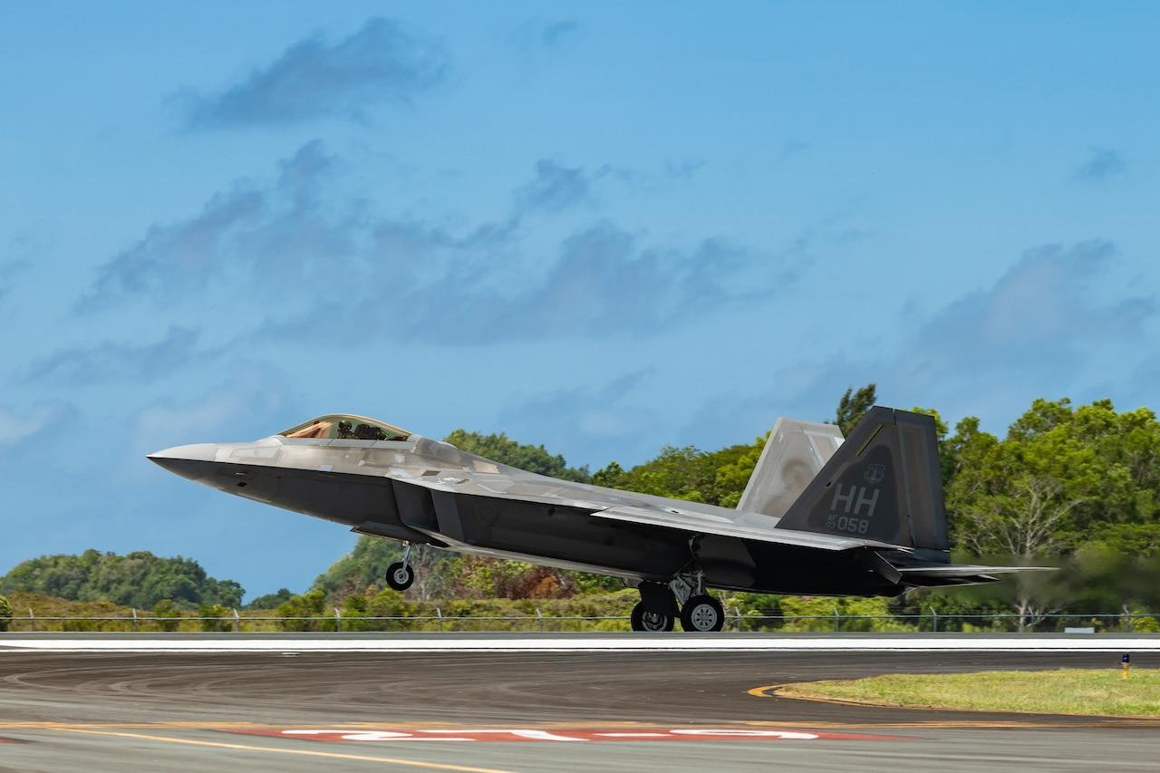 A jet lands on a runway.