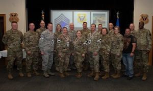 Four chief master sergeants select and current chief master sergeants from across Whiteman Air Force Base, Missouri, pose for a photo with Col. Jeffrey Shreiner and Chief Master Sgt. Katie McCool, the 509th Bomb Wing commander and command chief, on Dec. 4, 2019. By federal law, Airmen holding the rank of chief master sergeant make up only roughly one percent of Air Force manning. (U.S. Air Force photo by Staff Sgt. Kayla White)