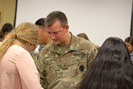 Army Sgt. Andrew Yosten, a combat medic and medical recruiter for the U.S. Army Medical Recruiting Station, Houston, works with premedical students during a Stop-the-Bleed Clinic during the American Medical Student Association Premed Fest at Texas A&M University Nov. 24.