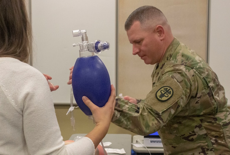 Army Lt. Col. James Hacker, certified nurse anesthetist, Carl R. Darnall Army Medical Center leads an intubation clinic for premedical students during the American Medical Student Association Premed Fest at Texas A&M University Nov. 24.