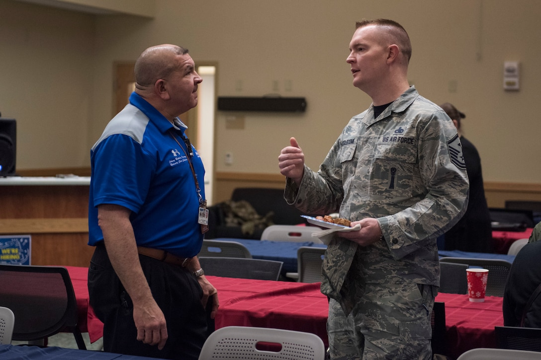 Jonathan Hernandez, Air Force Alaskan region recovery care coordinator, talks to U.S. Air Force MSgt. Jason Biddlecome, 3rd Operations Support Squadron first sergeant, during the annual Warrior Care breakfast, at Joint Base Elmendorf-Richardson, Alaska, Nov. 22, 2019. The event was held in honor of Military Appreciation and Warrior Care month, and featured guest speakers Alvin Shell and fellow Air Force Wounded Warriors. (U.S. Air Force photo by Senior Airman Caitlin Russell)