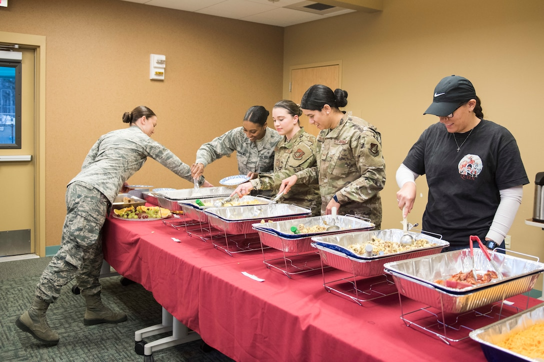 Joint Base Elmendorf-Richardson Airmen grab breakfast during the annual Warrior Care breakfast, at JBER, Alaska, Nov. 22, 2019. The event was held in honor of Military Appreciation and Warrior Care month, and featured guest speakers Alvin Shell and fellow Air Force Wounded Warriors. (U.S. Air Force photo by Senior Airman Caitlin Russell)