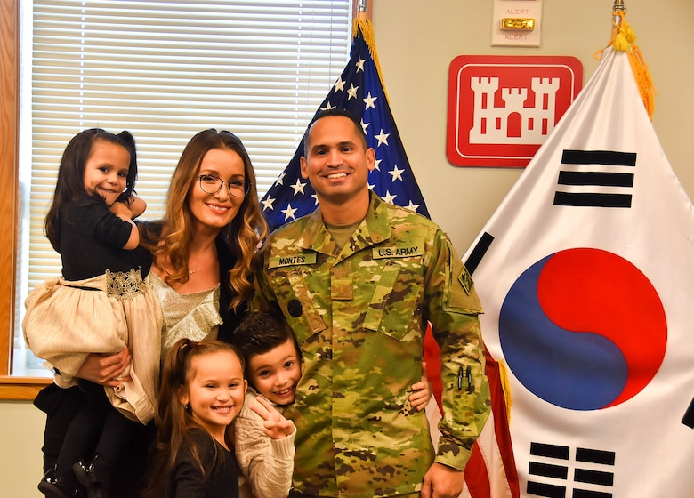 David Montes, a U.S. Army Corps of Engineers (USACE), Far East District (FED) project manager, with his family after he took the Oath of Office and was sworn in as a U.S. Army Second Lieutenant and Chaplain candidate, at the district headquarters, Camp Humphreys, South Korea. Montes' family and other members of the FED were present at his ceremony