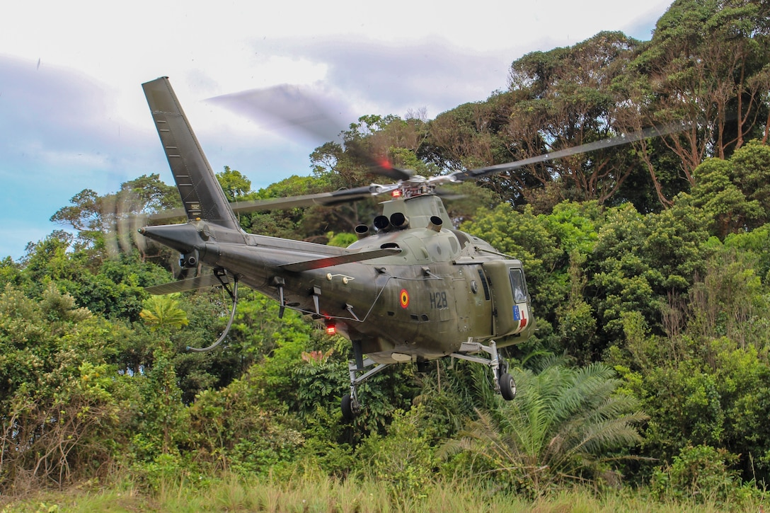 A Belgian Army AW109 Eurocopter with the 1st Wing Mobile Air Operation Team, prepares to land during a jungle survival training event in Akanda, Gabon, Nov. 20, 2019. U.S. Marines with Special Purpose Marine Air-Ground Task Force-Crisis Response-Africa 20.1, Marine Forces Europe and Africa, are working and training with partner-nation militaries giving U.S. forces the opportunity to refine processes and procedures, increase proficiency, and enhance the ability to respond to contingencies across the region. SPMAGTF-CR-AF is deployed to conduct crisis-response and theater-security operations in Africa and promote regional stability by conducting military-to-military training exercises throughout Europe and Africa. (U.S. Marine Corps photo by 2nd Lt. Andrew Soto)