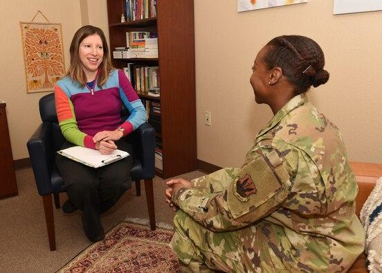355th Medical Group Mental Health clinic personnel discuss routine tasks at Davis-Monthan Air Force Base, Ariz., Nov. 27, 2019.