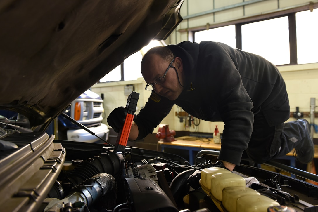 Neil Podd, 48th Logistics Readiness Squadron heavy mobile mechanic, performs an incoming quality inspection on a vehicle at Royal Air Force Lakenheath, England, Nov. 22, 2019. The main body of the government vehicle compound is composed of several buildings and serves multiple functions including electrical diagnostics, body work and maintenance.  (U.S. Air Force photo by Airman 1st Class Jessi Monte)