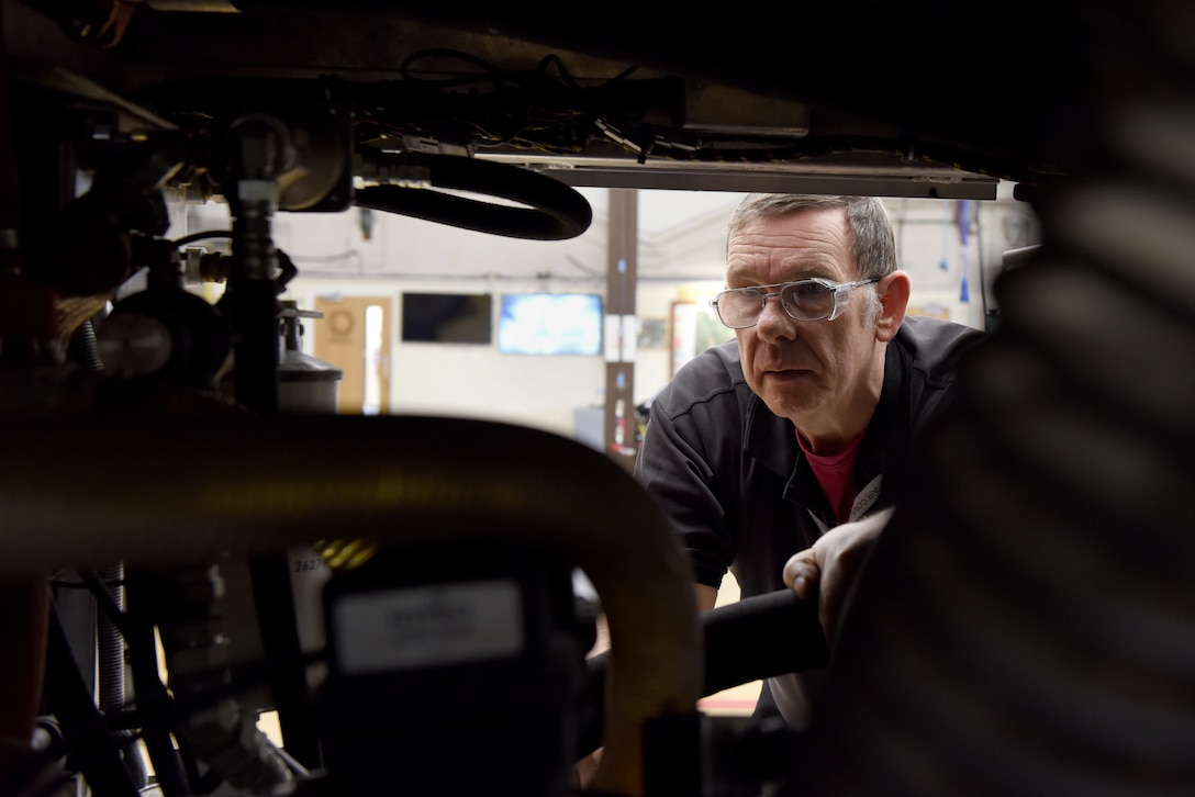 Robert Hook, 48th Logistics Readiness Squadron fire truck maintenance supervisor, inspects internal fire truck components at Royal Air Force Lakenheath, England, Nov. 22, 2019. The mission for fire truck maintenance is to provide quality service for the fire department vehicle fleet enabling protection for flying missions and structural facilities. (U.S. Air Force photo by Airman 1st Class Jessi Monte)