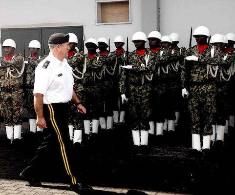 U.S. Army Maj. Gen. Jeff Marlette, South Dakota National Guard adjutant general, conducts a pass and review of Suriname Defense Force service members in Paramaribo, Suriname, Nov. 22, 2019. SDNG and SDF officials conducted a senior leader engagement as part of the State Partnership Program, which seeks to support security cooperation relationships by sharing experiences and best practices.