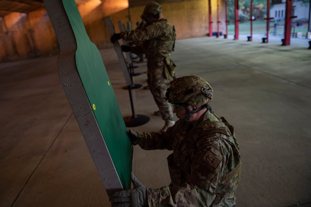 Photo of Airmen placing targets during an M4 and M9 Air Force Qualification Course