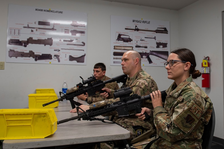 Photo of Airmen learning clearing procedures during an M4 and M9 Air Force Qualification Course