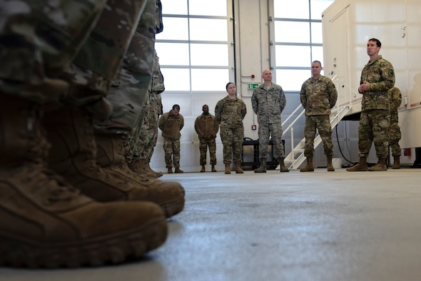 U.S. Air Force Col. David Epperson, 52nd Fighter Wing commander, right, speaks with Airmen from the 702nd Munitions Support Squadron at Buechel Air Base, Germany, Dec. 5, 2019. Epperson toured facilities around the geographically separated unit to gain a better understanding of the 702nd MUNSS's capabilities. (U.S. Air Force photo by Airman 1st Class Valerie Seelye)