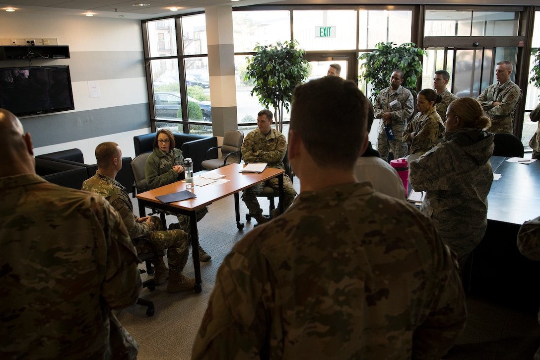 U.S. Air Force Senior Master Sgt. Shiloh Smith, 86th Logistics Readiness Squadron first sergeant, center, practices dispute resolution techniques during the Negotiation and Dispute Resolution Course held at the U.S. Air Forces in Europe and Air Forces Africa Conference Center, Ramstein Air Base, Germany, Dec. 4, 2019.
