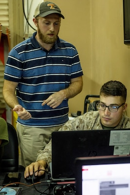 An engineering instructor provides a U.S. Marine with Combat Logistics Battalion (CLB) 24, attached to Special Purpose Marine Air Ground Task Force-Crisis Response-Central Command, with guidance during 3D print training in Kuwait, Aug. 28, 2019. A Marine Air Ground Task Force is specifically designed to be capable of deploying aviation, ground, and logistics forces forward at a moment's notice.  (U.S. Marine Corps photo by Sgt. David Bickel)