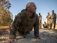 Staff Sgt. Matthew Driggers, fleet readiness center senior enlisted advisor with Marine Light Attack Helicopter Squadron 773, Marine Aircraft Group 49, executes a pushup during Martial Arts Instructor Course 1-20 aboard Naval Air Station Joint Reserve Base New Orleans, Dec. 4, 2019. The course consists of both physical and mental challenges to mold Martial Arts Instructors. (U.S. Marine Corps photo by Pfc. Colby Bundy)