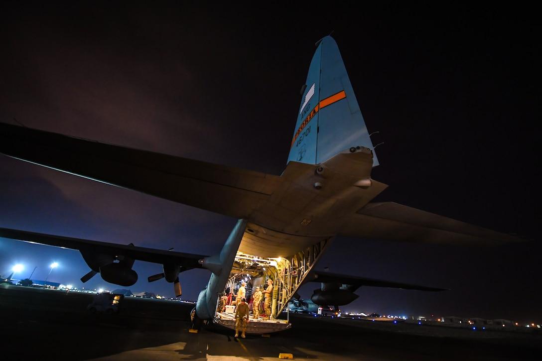 Airmen finalize pre-flight inspections on a C-130 Hercules