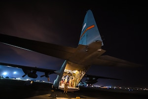 Airmen finalize pre-flight inspections on a C-130 Hercules