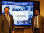 Michael Lanning and Contractor Ganesh Siva conduct a CPI Awareness session in the Buckeye Room Dec. 3 for the Level I Mentoring Program.