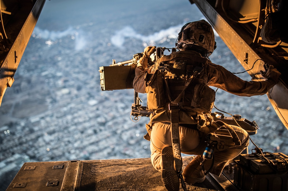 A U.S. Marine crew chief with Marine Medium Tiltrotor (VMM) 161 attached to Special Purpose Marine Air Ground Task Force-Crisis Response-Central Command 19.2 scans the horizon for enemy threats in an undisclosed location, Nov. 25, 2019. The SPMAGTF-CR-CC is a quick reaction force, prepared to deploy a variety of capabilities across the region.