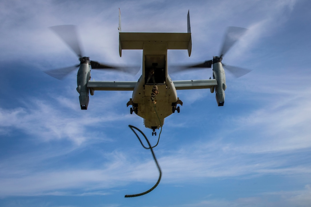 A U.S. Marine with 2nd Battalion, 3d Marine Regiment, fast ropes from a MV-22B Osprey assigned to Marine Medium Tiltrotor Squadron 363 during fast roping drills, Marine Corps Base Hawaii, Nov. 26, 2019. The training was designed to produce readiness by building confidence, familiarize the Marines with air assets, and prepare them for crisis response operations.