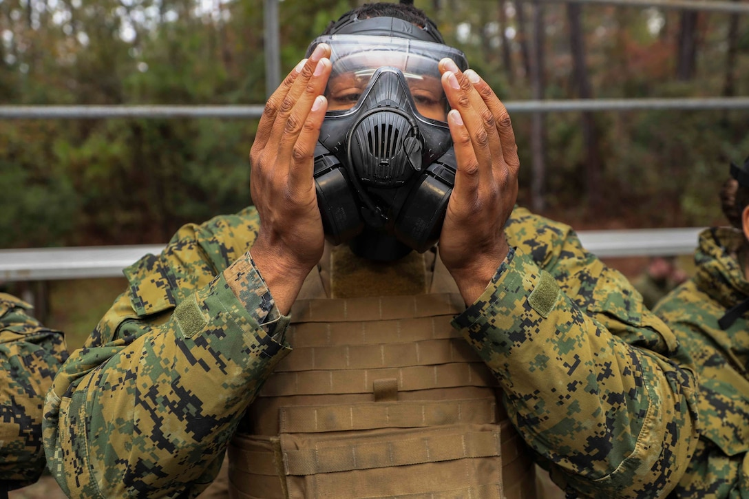 U.S. Marine Corps Lance Cpl. Brennon Gant, an administrative specialist with the 22nd Marine Expeditionary, Unit test his gas mask prior to an Individual Protective Equipment Confidence training at the gas chamber aboard Camp Lejeune, N.C., Nov. 15, 2019. The exercise helps familiarize Marines and Sailors with their CBRN equipment and enhance their proficiency in CBRN defense situations.