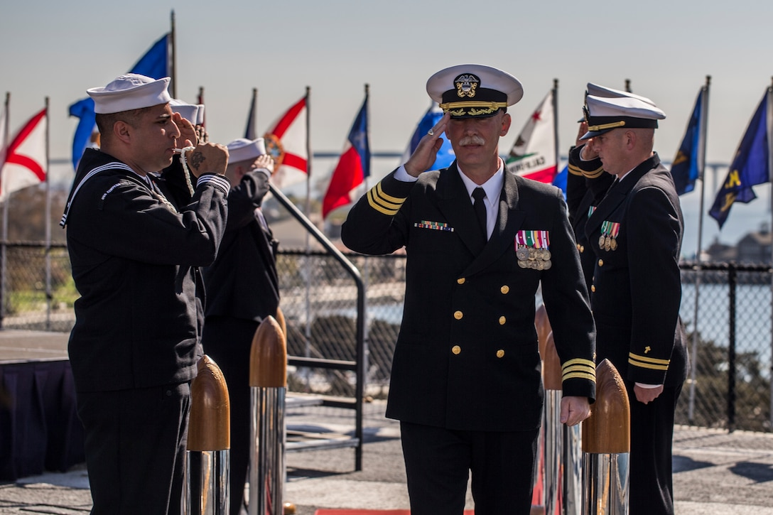 Cmdr. Doran Kelvington, Marine Corps Recruit Depot, San Diego, Recruit Training Regiment Chaplain conducts the end of his retirement ceremony, a Naval tradition known as rendering honors. Rendering honors is a tradition practiced to honor officers as they aboard or depart a Navy ship.