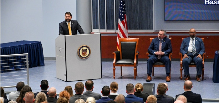 Naval Criminal Investigative Service (NCIS) Director Omar Lopez speaks during an NCIS Agent graduation ceremony at the Federal Law Enforcement Training Center in Glynco, Georgia, Nov. 22, 2019.