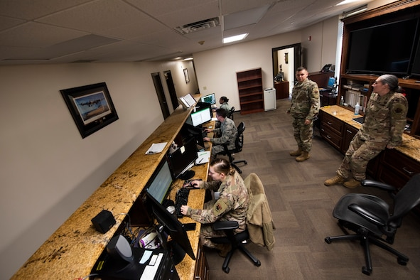 A photo of Airmen checking weather forecasts