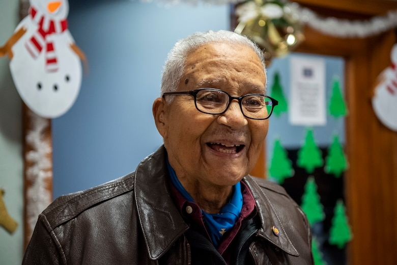 Former Tuskegee Airman, retired Col. Charles McGee, celebrates his birthday Dec. 6, 2019, at Dover Air Force Base, Del. McGee was born in Cleveland, Ohio, Dec. 7, 1919. He served a total of 30 years in the U.S. Air Force, beginning with the U.S. Army Air Corps, and flew a total of 409 combat missions in World War II, Korea and Vietnam. The Tuskegee program began in 1941 when the 99th Pursuit Squadron was established, and its Airmen were the first ever African-American military aviators in the U.S. Army Air Corps. (U.S. Air Force photo by Senior Airman Christopher Quail)