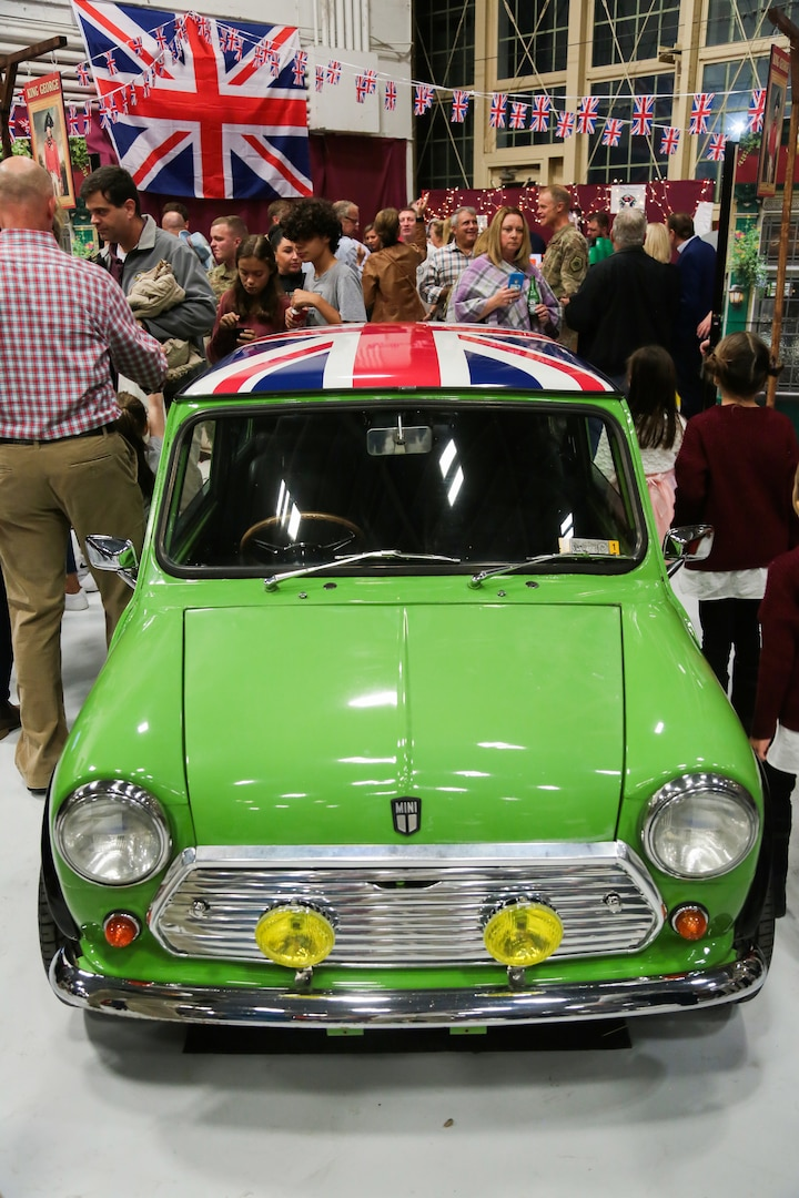 A vintage MINI Cooper automobile is displayed at USCENTCOM's 16th annual Coalition International Night in Hangar 5 at MacDill Air Force Base (AFB), Dec. 5, 2019. International Night started in December 2004 as a winter holiday party for the Coalition members and families. This year, members of 37 coalition countries displayed native customs and offered a taste of their traditional cuisines to over 1,700 guests. (U.S. Central Command Public Affairs photo by Tom Gagnier)