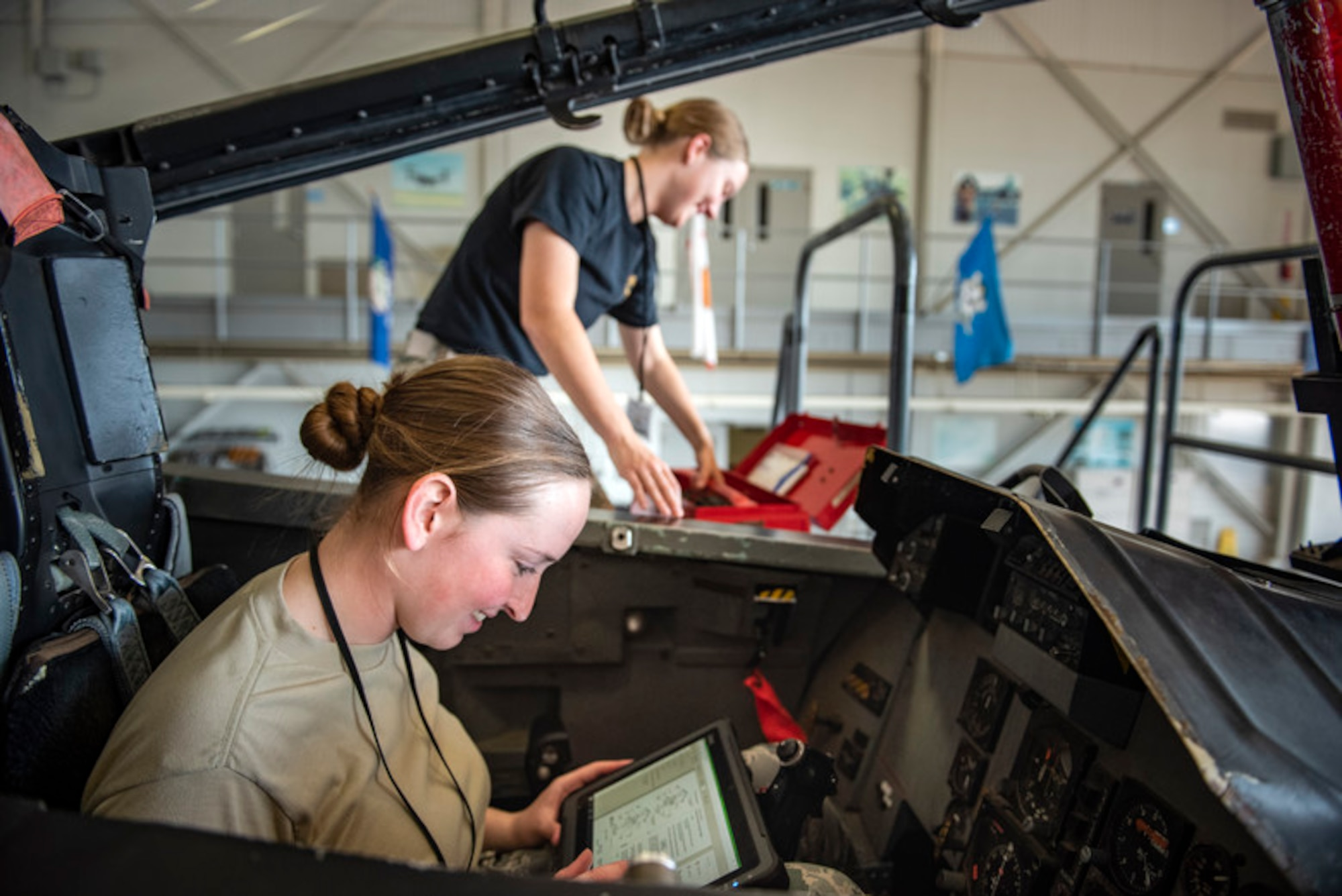 Airman 1st Class Christine Smith and Airman 1st Class Kaylie Cunningham, 364th Training Squadron electrical and environmental apprentice course students, remove and install an oxygen regulator on an F-15 Eagle at Sheppard Air Force Base, Texas, June 14, 2019. In an effort to expand learning opportunities for Airmen and enable training and education from any device, Air Education and Training Command has begun the Learning Wi-Fi Service project to install commercial wireless Internet across the command's installations. (U.S. Air Force photo by Airman 1st Class Pedro Tenorio)