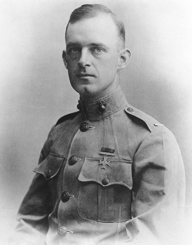 An early 1900s official photo of a Marine officer in dress uniform.