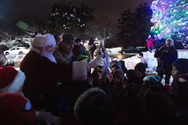 Lt. Col. Charles Silvanic, 66th Air Base Group and installation vice commander, Santa Claus, and base children, switch on the lights of the holiday tree during the 2019 tree lighting ceremony on Hanscom Air Force Base, Mass., Dec. 4. The annual event featured holiday carols by the Hanscom Middle School select choir, hot chocolate and cookies, and an ice sculpture display. (U.S. Air Force photo by Lauren Russell)