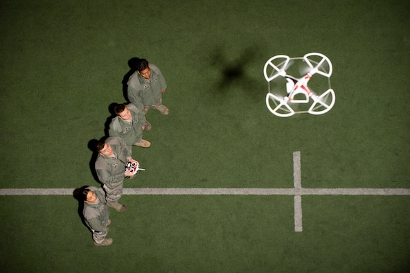 United States Air Force Academy Cadets in the Unmanned Aerial System (UAS) Operations Program familiarize themselves with quadcopter flight controls at The Cadet Field House, Monday March 4th, 2019. (U.S. Air Force photo/Joshua Armstrong)