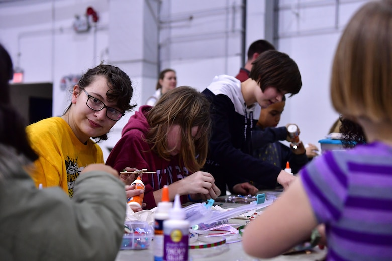 Children make cards for Santa at the crafting station during the Red-Nosed Herk holiday celebration.