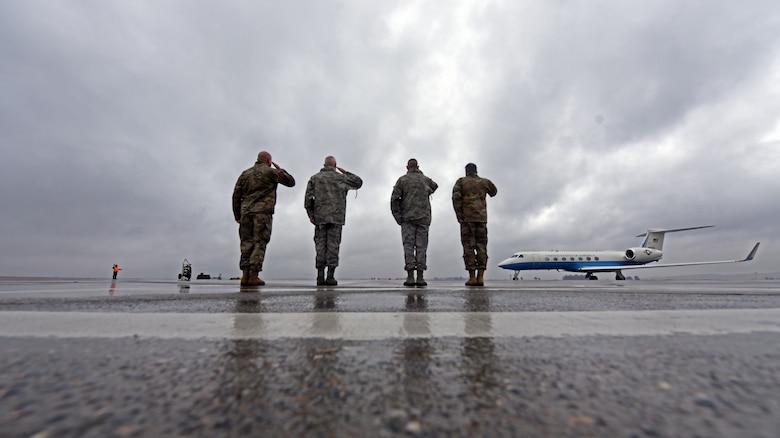 U.S. Airmen salute aircraft.