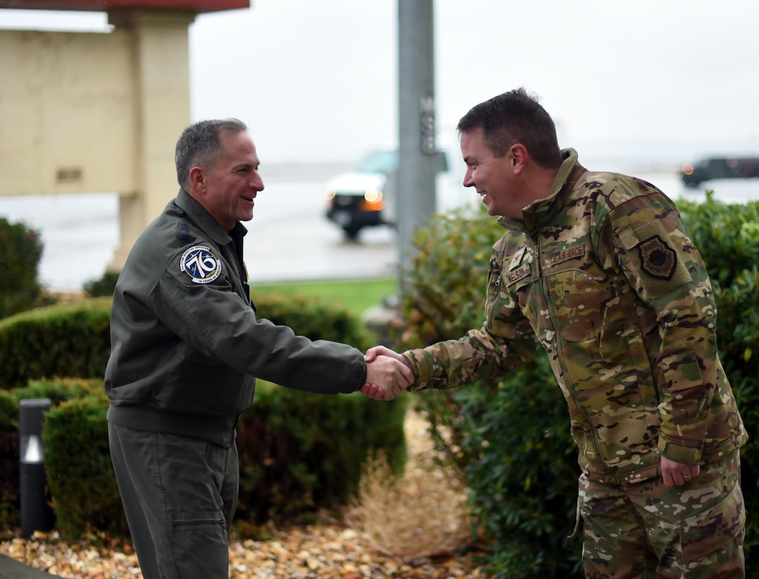 Air Force Chief of Staff Gen. David L. Goldfein greets Col. Jeff Nelson, 60th Air Mobility Wing commander.