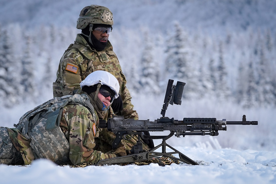 Paratroopers assigned to the 2nd Battalion, 377th Parachute Field Artillery Regiment, 4th Infantry Brigade Combat Team (Airborne), 25th Infantry Division, U.S. Army Alaska, wit for the order to load an M240B machine gun while conducting live-fire qualification at Grezelka range, on Joint Base Elmendorf-Richardson, Alaska, Dec. 5, 2019. The Soldiers practiced identifying, and engaging targets at varying distances to solidify their proficiency with the weapons in sub-arctic conditions.